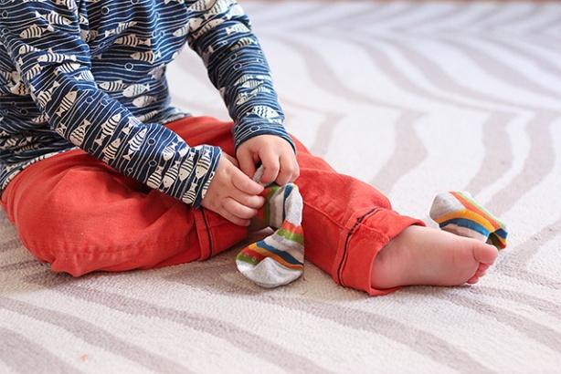 toddler-putting-on-socks-wearing-winter-water-factory